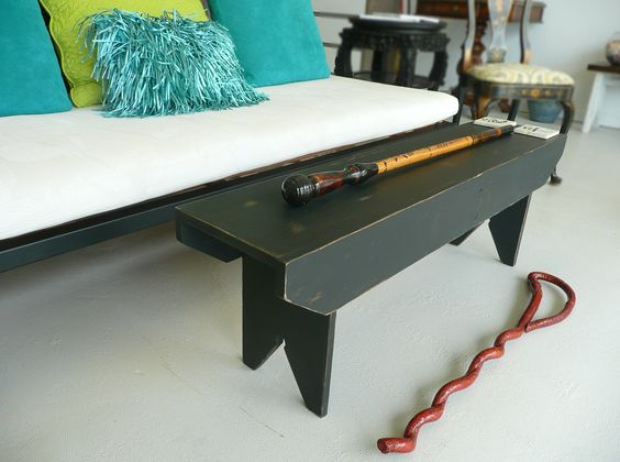 Asian modern coffee table with totem sitcks. Great for a small space too!