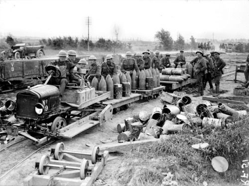 Captured ammunition being sent to the front - Flanders, August 1917.