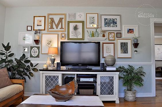 A great way to decorate around your flatscreen tv. Add pictures of different sizes and other wall art and the tv blends into the mix.