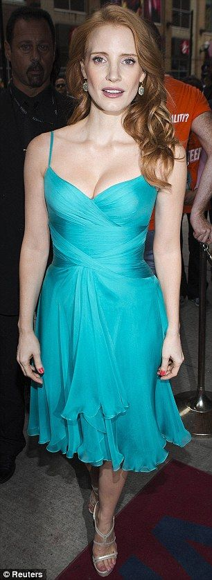 Raising temperatures: Jessica's dress was fitted at the bust, displaying plenty of her decolletage