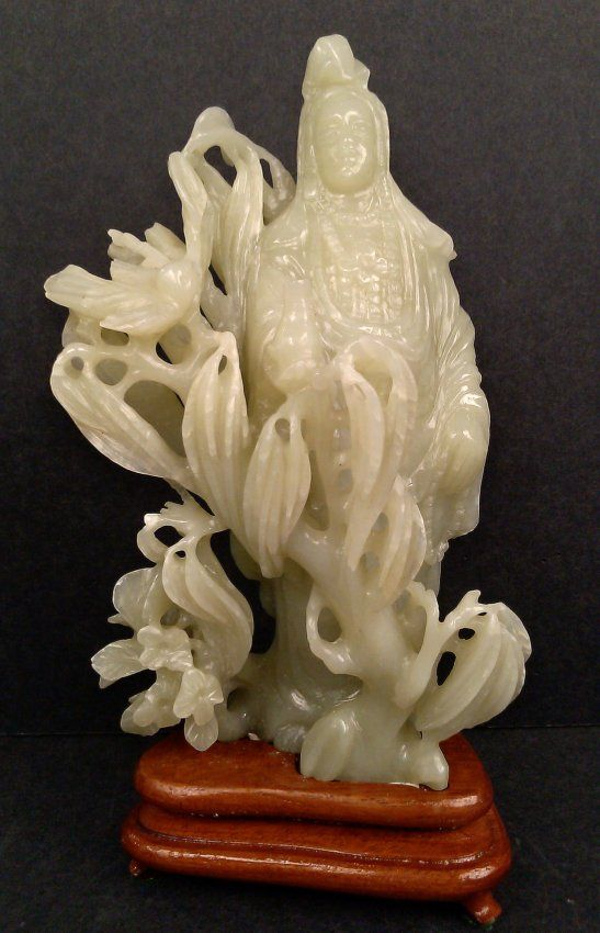 A JADE CARVING OF GUINYIN FIGURE