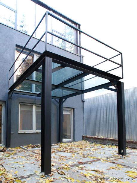This private backyard is rejuvenated by the presence of for Steel balcony