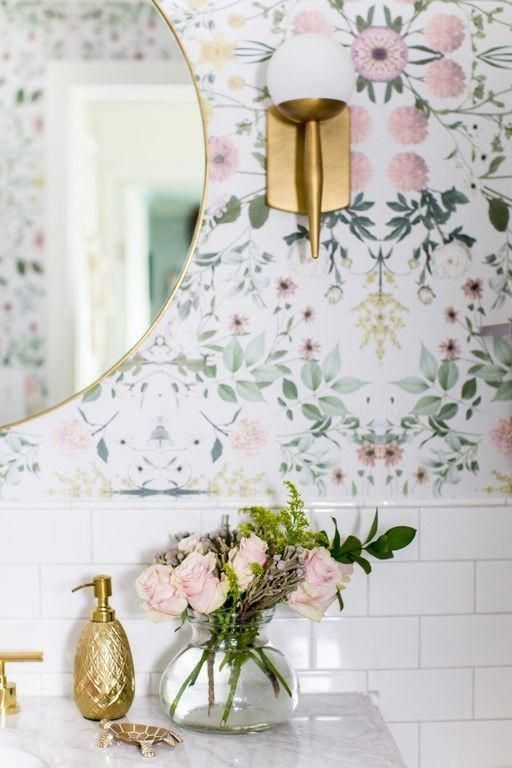 Bathroom Reveal! Check out this beautiful DIY bathroom with pink floral wallpaper, brass accents, a round mirror, marble vanity, subway tiles. It's a girly decor dream! For a small bathroom it sure is big on style! #BathroomRemodel