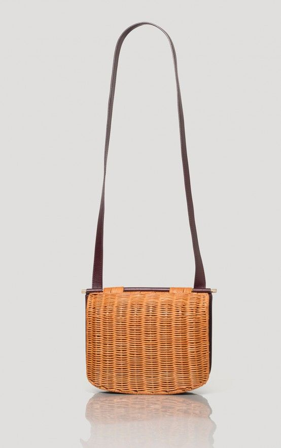 Cross-body bag in Italian vegetable-tanned calf leather. Custom wicker front panel made in the Philippines. Flap opening with magnetic closure. #rachelcomey
