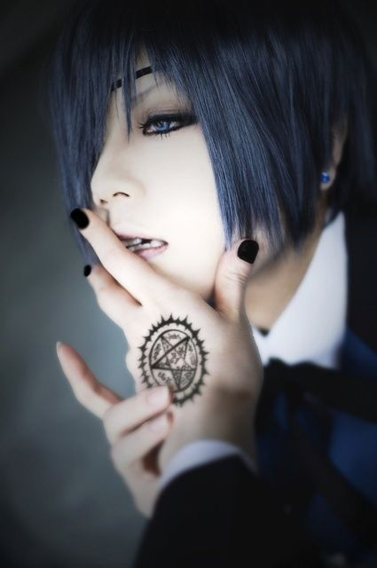 Ciel -pinning for the sheer fact that this pisses me off. Ciel never had black nail polish and his mark isn't on his hand!!! That was Sebastian. Other than that tho is a pretty good cosplay.