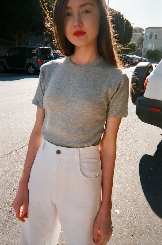 red lips, grey tee and high-waisted white jeans: