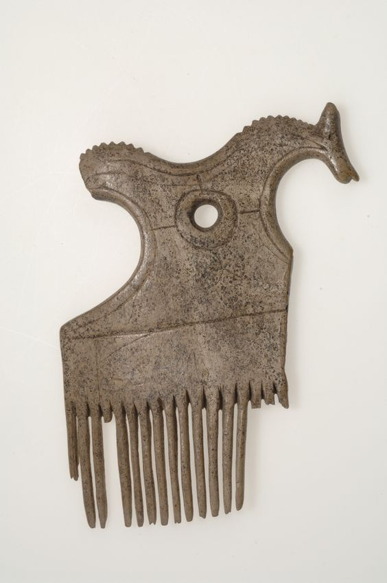Viking comb made of bone/antler. The comb has an animal-shaped head, perhaps that of a horse. Björkö, Sweden.