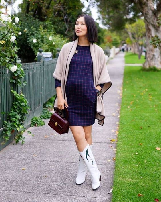 Pin for Later: 38 Superchic Maternity Outfits to Help You #StyletheBump A Patterned Dress, Statement Boots, and a Jumper
