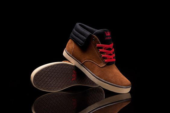 Lizard King's signature Passion with a brown suede upper, red accents, a black canvas flap and tongue, padded black mesh lining, all on a gum vulcanized sole with an off white foxing and grey stripe.