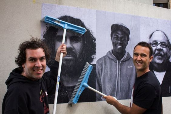 A street art project showcasing the history of Aboriginal and Torres Strait Islanders and their need for Constitution recognition has begun at the University of Tasmania in Sandy Bay. Tasmanian University Union's Ariel Wells and Peter Dawson paste some of the posters. (Image: ABC/ Damien Peck) #art #indigenous #pasteup