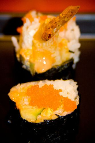Queen of the Tom Tom Roll- Tempura Shrimp, Cream Cheese, avocado, cucumber, tobiko, and spicy sauce
