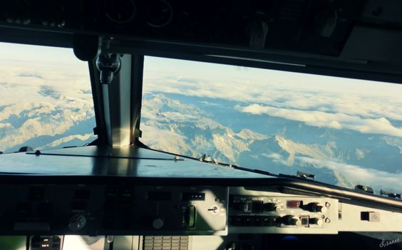View over the alps from cockpit  #Flying #Alps #airplane #view #clouds #travel #reizen #Europe #cockpit