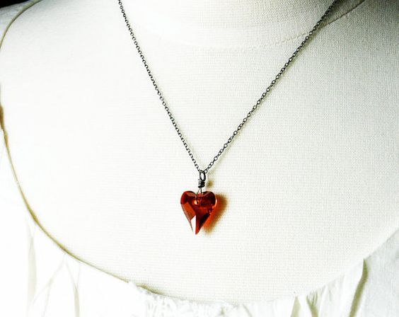 I think it's either hte asymmetry of the cut or the color that really draws me to this piece.  http://www.etsy.com/listing/61318269/ardor-necklace-red-swarovski-crystal
