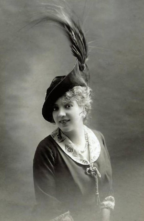 Actress ArlctteDorgere in a velvet hat with a tuft of feathers from a bird of paradise, Paris, 1914: