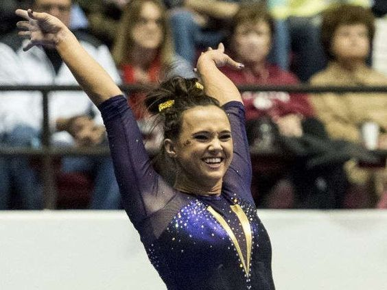 LSU gymnastics vaults by basketball and baseball in attendance