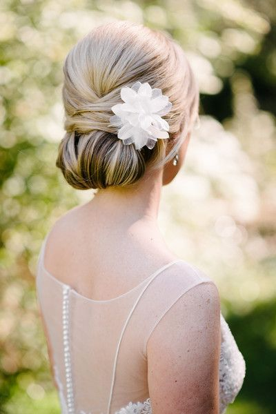 Jaimie in @watterswtoo Jacinda gown. She wore her hair in a classic chignon, adorned with a fabric flower.