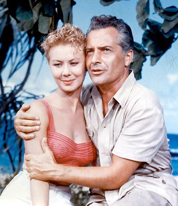 """Emile de Becque (Rosanno Brazzi dubbed by Giorgio Tozzi) to Nellie Forbush (Mitzi Gaynor): [singing] """"Some enchanted evening / You may see a stranger, you may see a stranger / Across a crowded room / And somehow you know, you know even then / That somewhere you'll see her / Again and again."""" -- from South Pacific (1958) directed by Joshua Logan"""