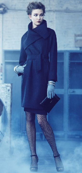 Gorgeous navy coat, grey leather gloves, gold accessories, black clutch and awesome lace pantyhose