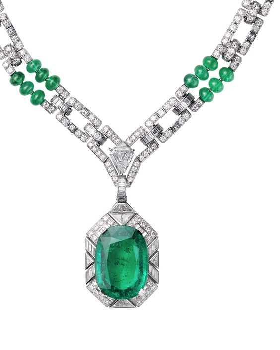 Cartier Viracocha Necklace - Platinum, one cushion-cut emerald (26.60 carats) from Colombia, one cut-cornered triangular step-cut diamond (2.02 carats), emerald beads, calibré-cut diamonds. The emerald pendant can be removed.