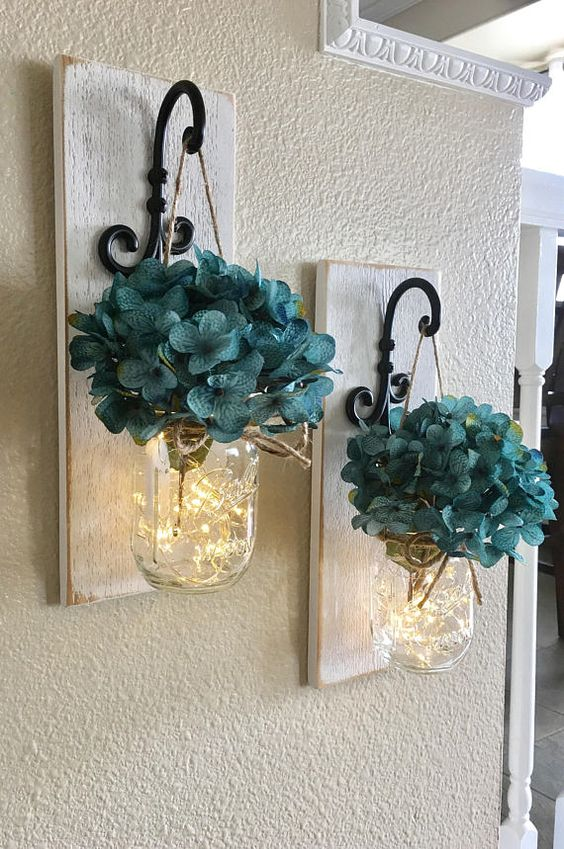 This is a beautiful set of 2 or 3 mason jar wall sconces. It includes two sconces, hanging mason jars and flowers. The sconce measures 14 tall and 5 wide. Jars are pint size. FLOWERS AND LIGHTS BATTERY OPERATED FAIRY LIGHTS INCLUDED!! BATTERIES ARE PROVIDED! {The fairy lights are