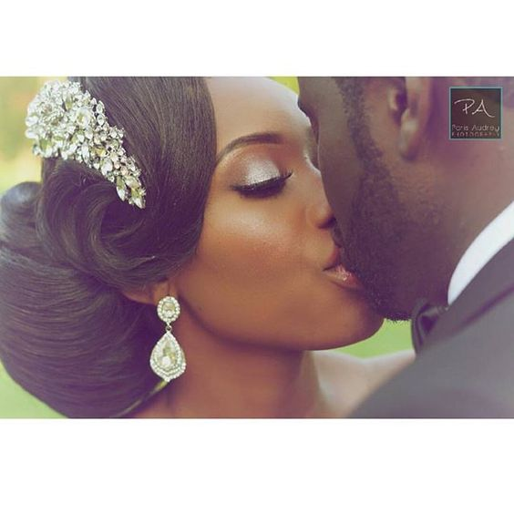Wow! The hair  the headpiece  the kiss  lovely couple @mzyeboah_00 & @chriss_a0 ! Photo by @parisaudreyphotography | #BellaNaijaWeddings