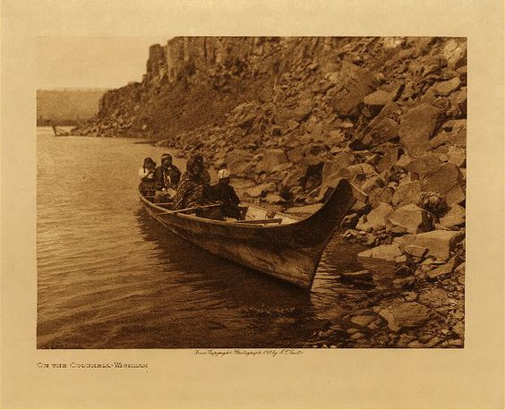 c 1909 Chinook tribal group in canoe on Columbia River near now flooded Celilo Falls and the village of Wishram. The animal effigy on the prow of the canoe was a common canoe design along the Oregon coast and down the Columbia River. photo: Edward S. Curtis (Native American, Indian):