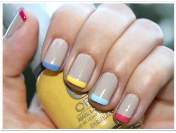 Multi-colored pastel French tips with a muted tan base coat...very cute and summery!