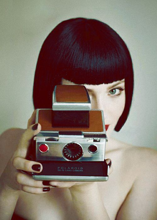 Holliday Grainger with Polaroid SX-70