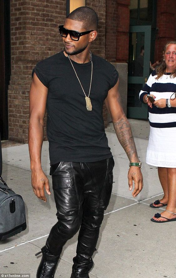 Yeah! Usher stepped out in a short-sleeve black top and leather trousers in New York City ...