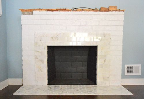 Fireplace tiles fireplaces and house on pinterest - Tiling a brick fireplace ...