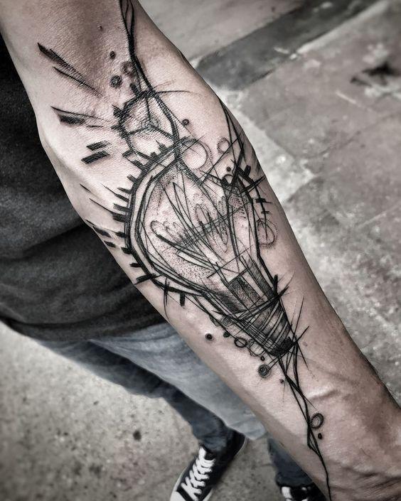Fine line lightbulb tattoo