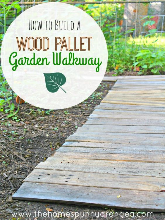 Create your own wood pallet garden walkway, perfect for keeping your feet dry and weeds at bay.