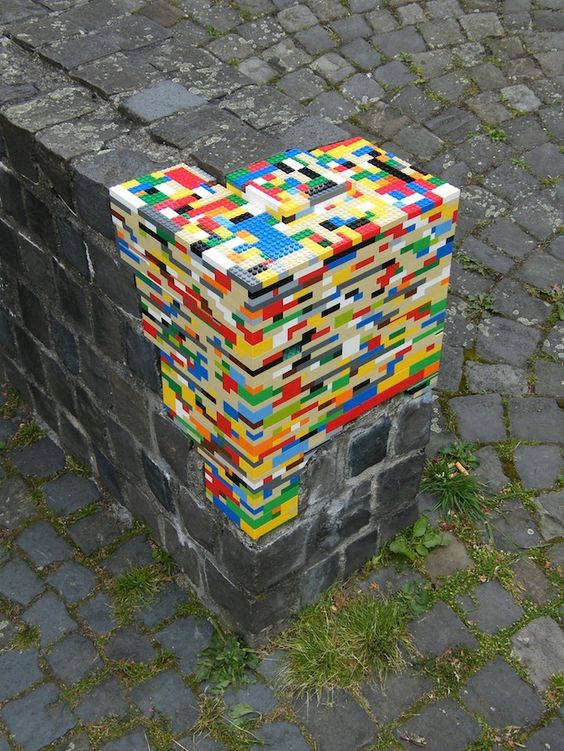 Lego repairs to crumbling wall.