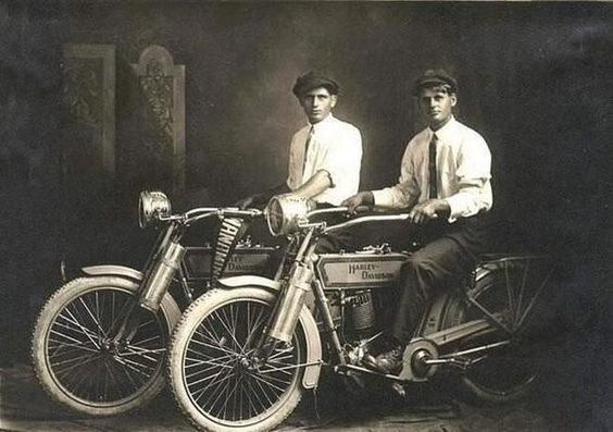 William Harley and Arthur Davidson with their motorcycles in 1914