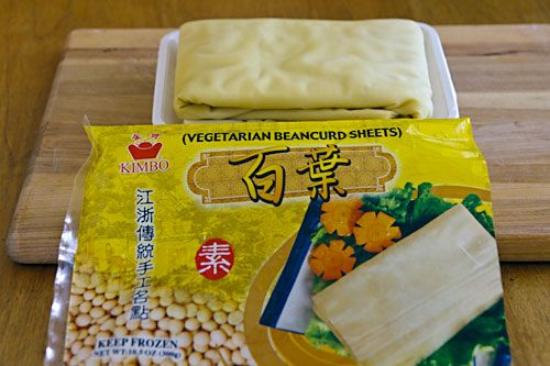 """Tofu Sheets: Tofu pi, the skin that forms on soymilk, and bai yeih, a thicker sheet of pressed tofu.  Bai yeih is tougher and less delicate to work with and results in a chewier """"chicken,"""""""