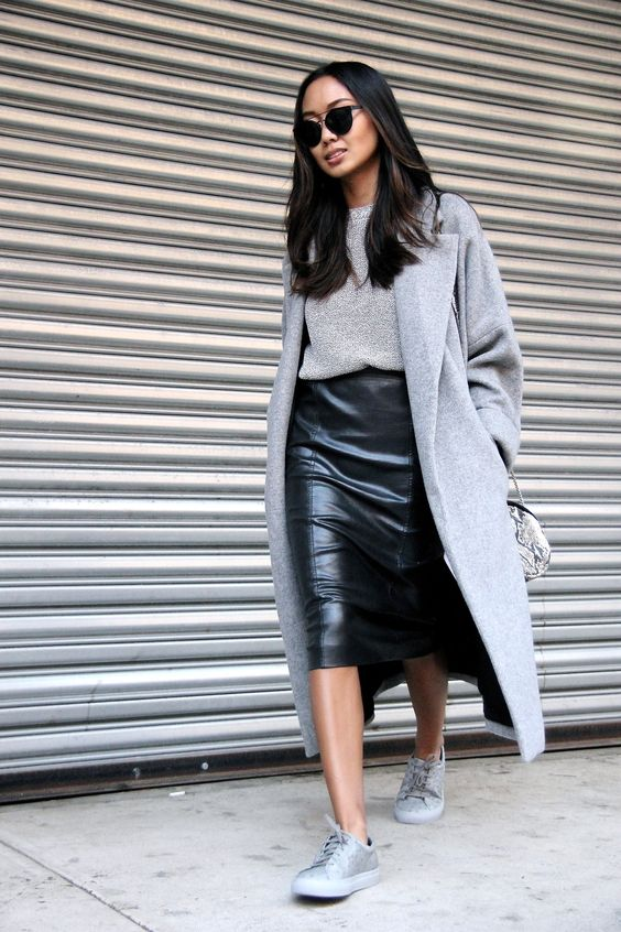Linh Niller // black sunglasses, grey coat, knit sweater, leather skirt and grey embossed sneakers: