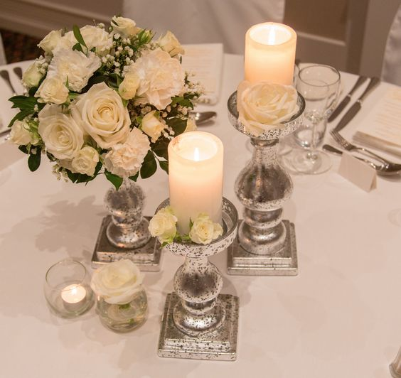baroque stands with flowers and candles white  low centrepiece