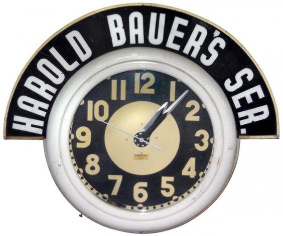 Cleveland neon clock w/Harold Bauer's Service