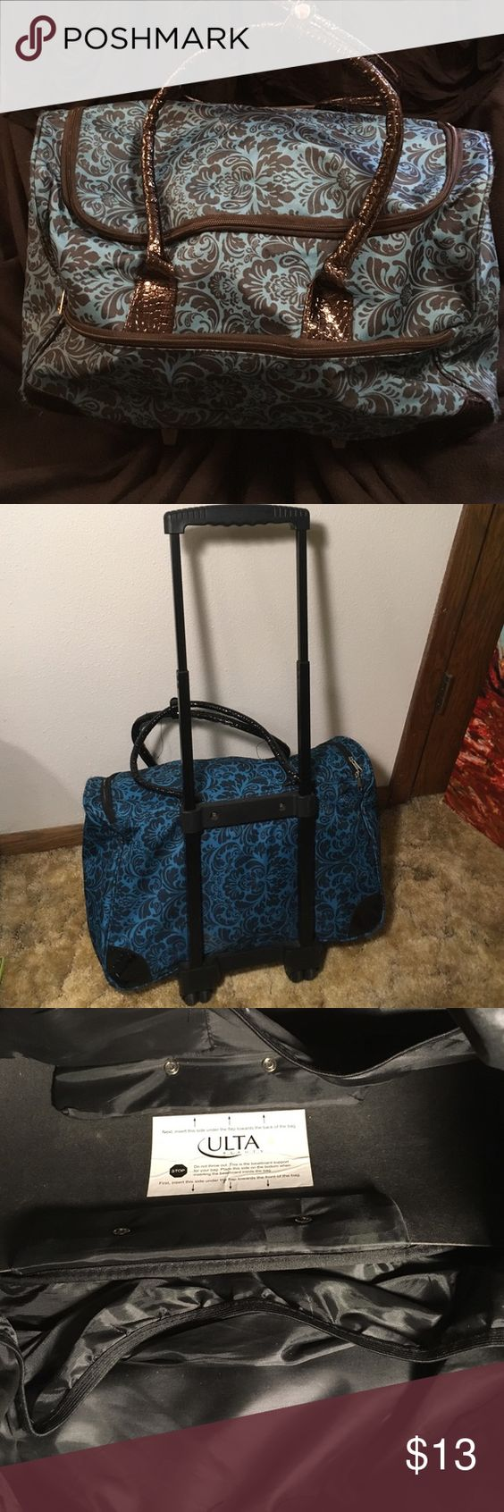 Teal weekend bag Cary on sized weekend bag with wheels. Mild wear. Ulta Bags Travel Bags
