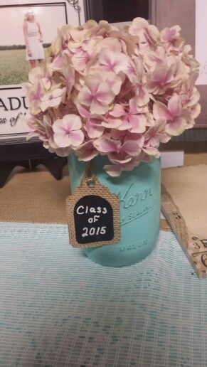 Painted  mason jars, country chic with fresh flowers simple but beautiful.