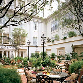 SOUTHERN CHARM-NEW ORLEANS - The courtyard of the Ritz Carlton Hotel in New Orleans #NOLA