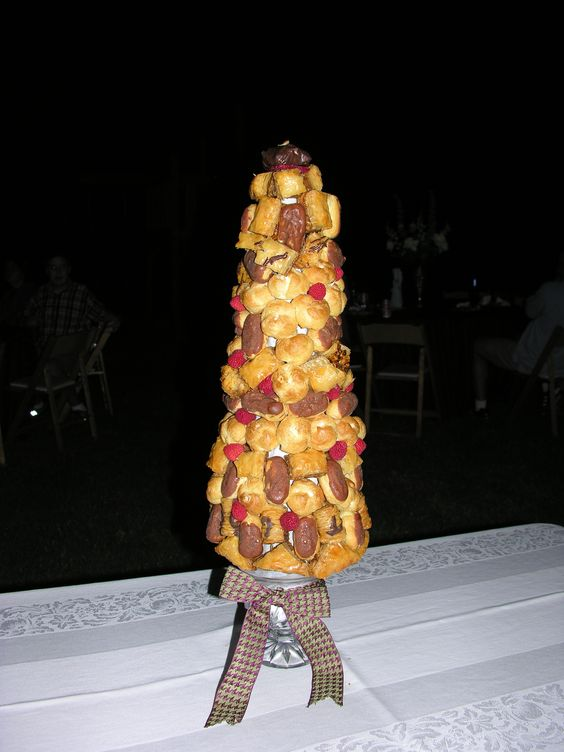 Chocolate eclairs and cream puff tower