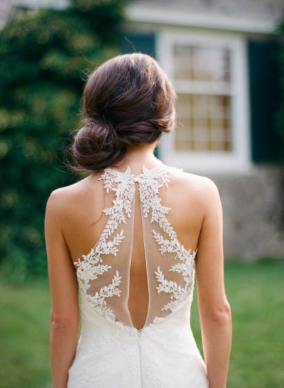Add a point of visual interest to an illusion back wedding dress with a keyhole cut and extra detailing.