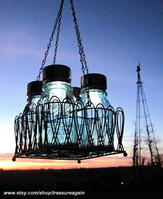 Mason Jar Chandelier with Solar Lights    If you seriously don't know what to do with your Mason Jars and both the mason jars garden lanterns and mason jar flower shelf are not the option, consider this cool idea:    Creative mason jar chandelier powered by sun!    You will need 4 mason jars, 4 Solar Light LIDS, and some creativity! Gotta love the light and color play!