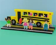 Back to School Designed By The Perler Design Team This fun project helps kids get in the mood for heading back to school. It's easy with Perler beads! Make it a family project, or present it as a gift to the teacher.