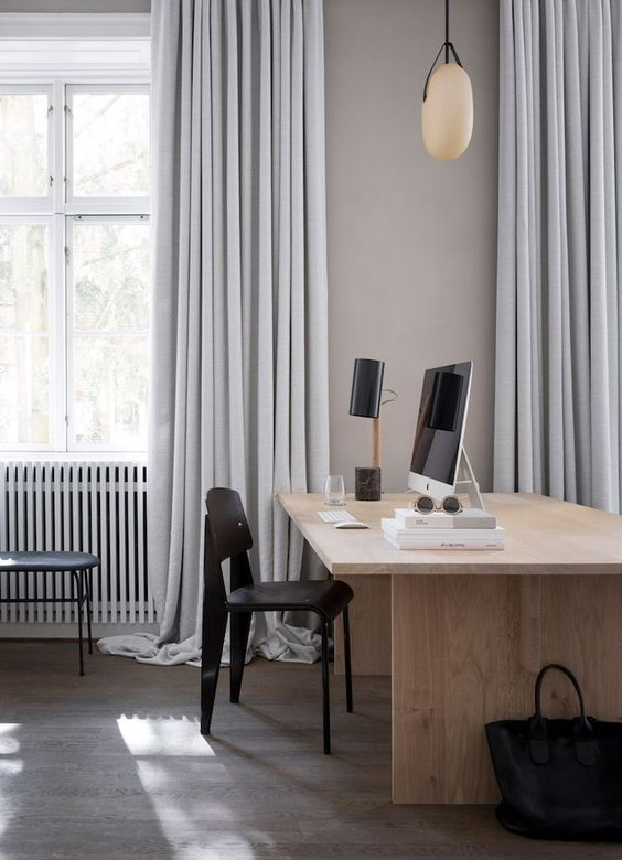 The Kinfolk gallery and office space | love those full length grey curtains puddling to the floor and simple wooden office furniture