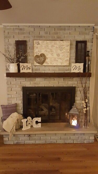 White wash fireplace fireplaces and decor on pinterest Brick fireplace wall decorating ideas