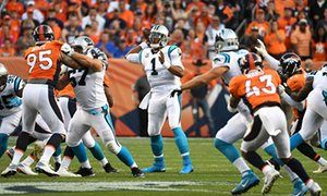 Cam Newton (1) attempts a pass in the first quarter.