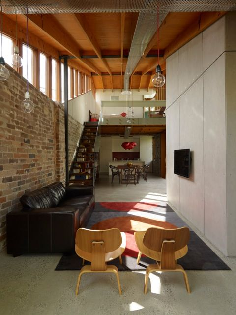 A band of clerestory windows illuminates the interior of this house in Australia. The walls are recycled brick, whose thermal mass insulates the house. Photo by Brett Boardman.http://www.dwell.com/house-tours/slideshow/renovated-house-australia