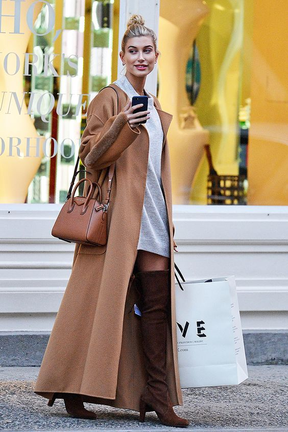 The key to keeping warm? Wrapping up. If you're keen to avoid bulky layers, try a full-length maxi coat like Hailey Baldwin. Bust a look and keep cosy, win win!